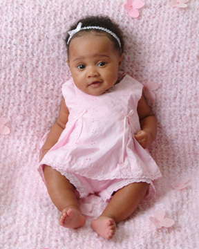 baby photograph of 3 month baby girl in pink dress sitting ...