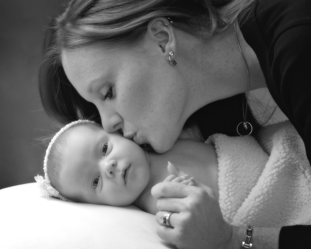 Mom kissing laying down baby portrait by Cleary Creative Photography in Dayton Ohio