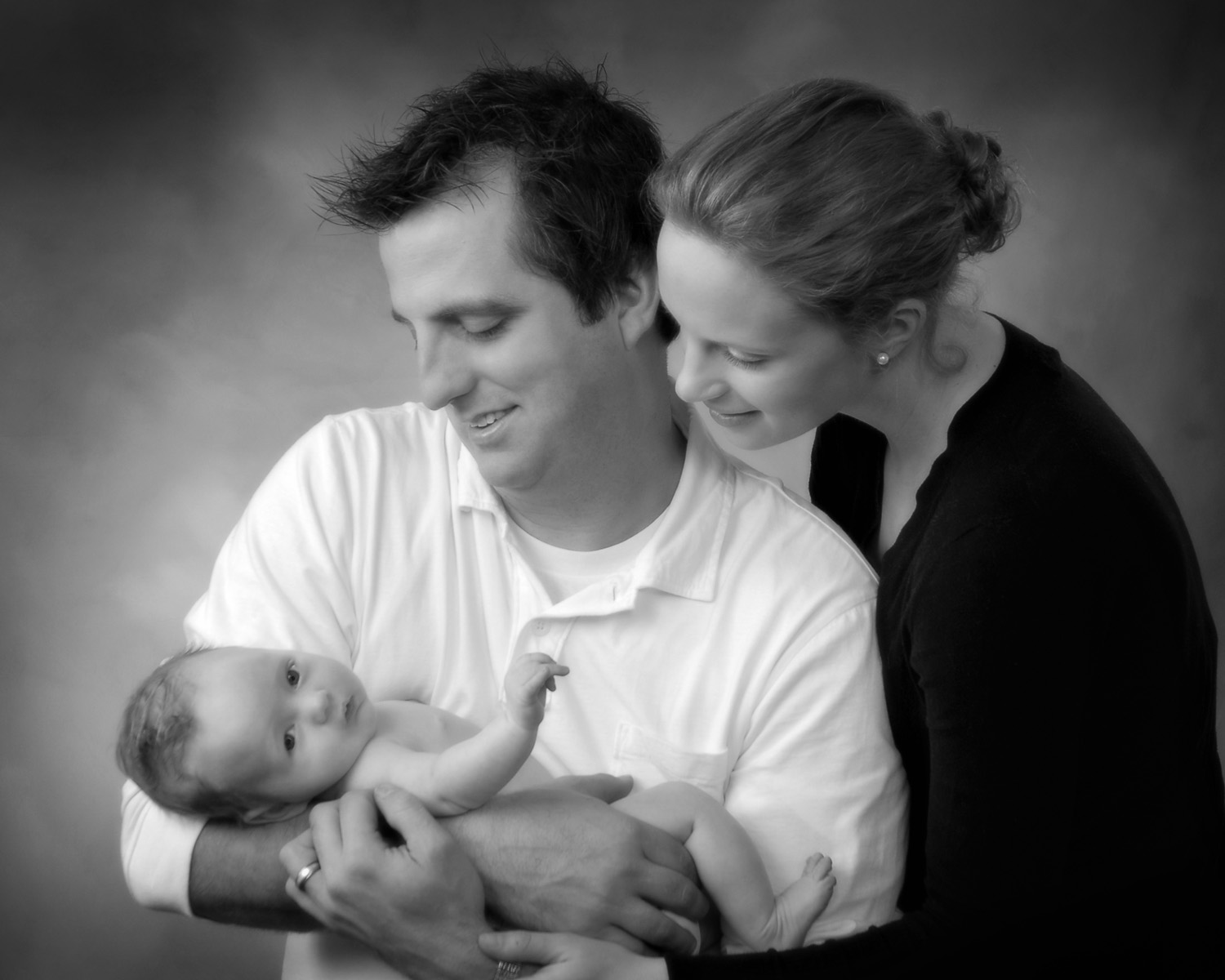 black and white portrait of Mom holding onto baby by Cleary Creative Photography in Dayton Ohio
