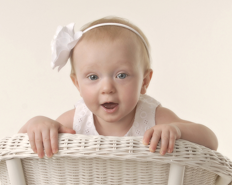 one year old baby girl sitting backwards on a chair by Dan Cleary of Cleary Creative Photography of Dayton Ohio