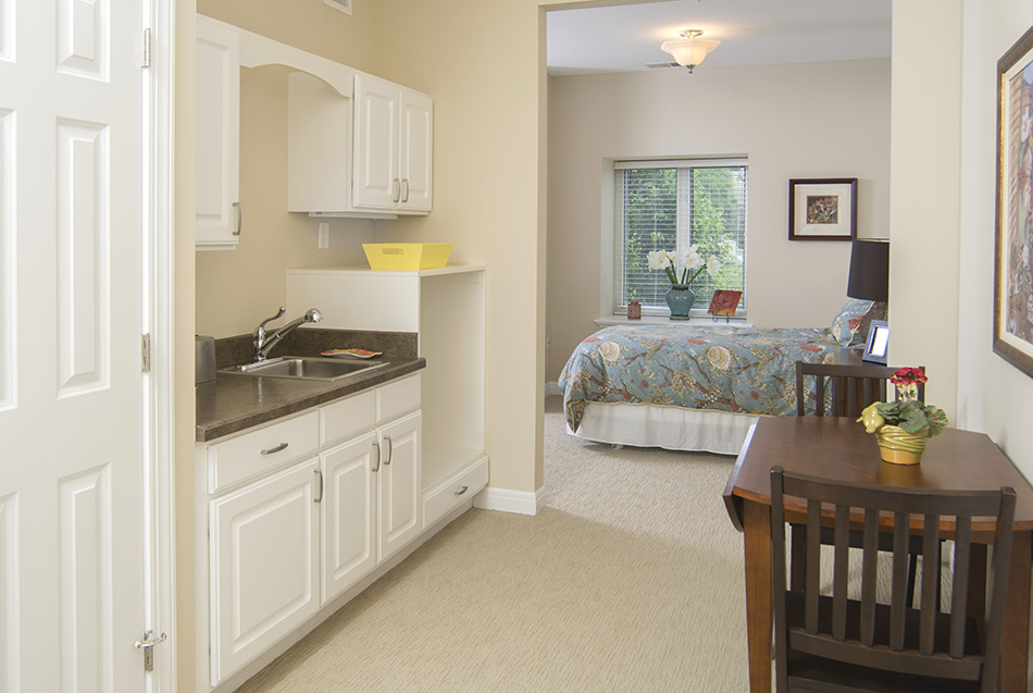 Interor photograph of retirement apartment kithchen and bedroom by Dan Cleary of Cleary Creative Photography in Dayton Ohio