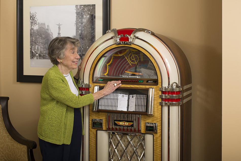 interior photograph at Kenwood Retiement building nurse woman with a juke box by Dan Cleary of Cleary Creative Photography in Dayton Ohio