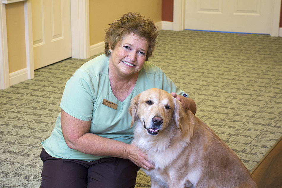 photograph Kenwood Retiement building nurse with a dog by Dan Cleary of Cleary Creative Photography in Dayton Ohio