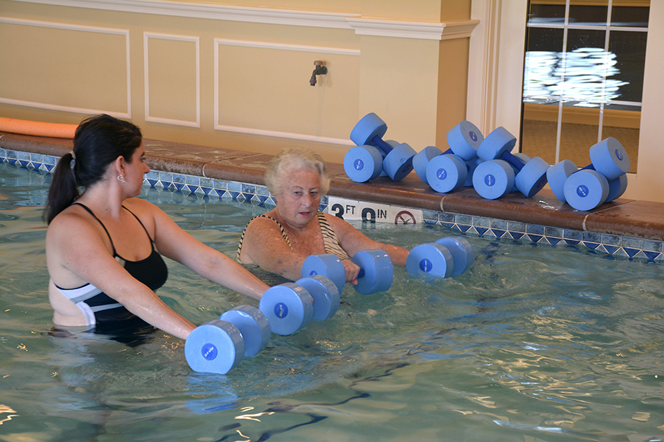 photograph Kenwood Retiement building of elderly woman working out in the pool by Dan Cleary of Cleary Creative Photography in Dayton Ohio