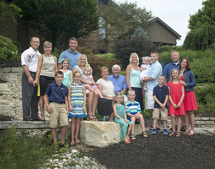 Family in their backyard on rocks by Cleary Creative Photography in Beavercreek Ohio