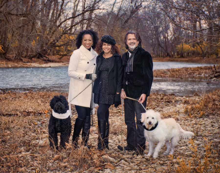 Family portrait with their dogs by Miami River by Cleary Creative Photography in Dayton Ohio